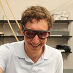 Jason Bartell in an optics laboratory